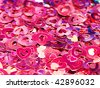 Pink heart-shaped confetti background, close-up - stock photo