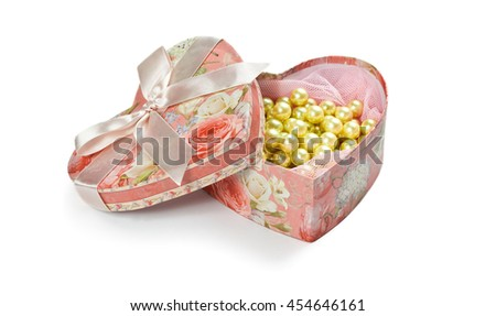 Pink heart shaped jewel box isolated on white