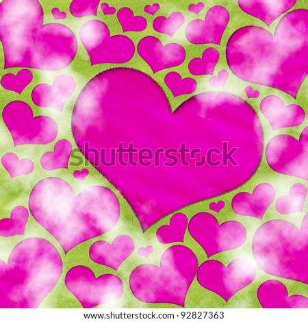 Pink heart-shaped pond in the meadow