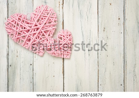 Pink hearts on a white wooden background - stock photo