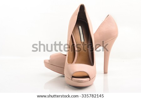 Pink high heel women shoes on white background - stock photo