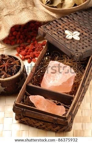 Pink Himalayan rock salt in a basket - stock photo