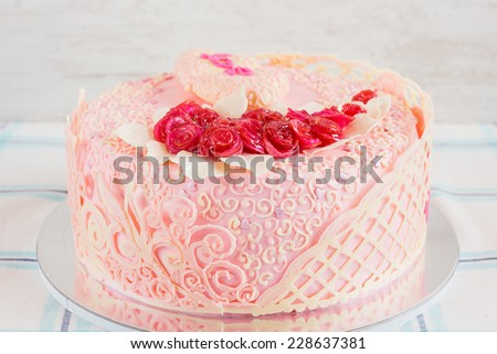 Pink homemade wedding cake with pink roses