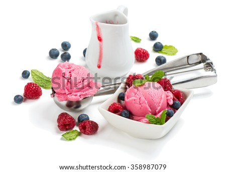 Pink ice cream of berry, fresh raspberries, blueberries and sauce,  isolated on white background. - stock photo