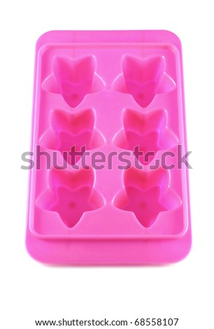 Pink ice tray star shape isolated on white background - stock photo