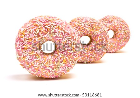 Pink Iced Doughnut abstract covered in sprinkles isolated against white background. - stock photo