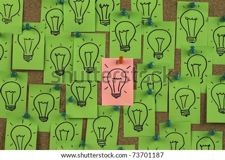 Pink idea  standing out from group of green ideas. - stock photo