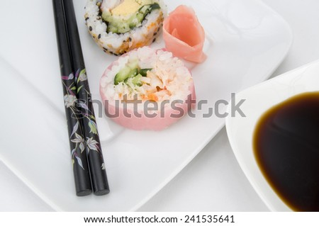Pink Japanese Sushi with Chopsticks and Soy Sauce Close Up - stock photo