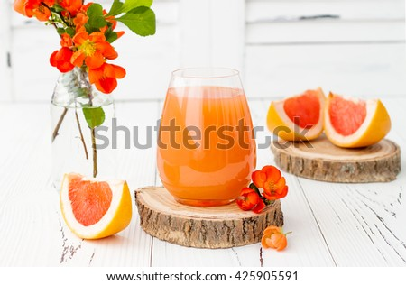Pink juicy homemade grapefruit cocktail with alcohol over old vintage wooden table, selective focus  - stock photo