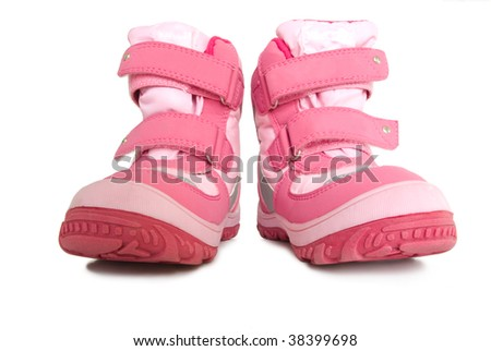 Pink kid's warm boots. Isolated on white background.