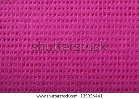 Pink kitchen sponge rubber foam as background texture - stock photo