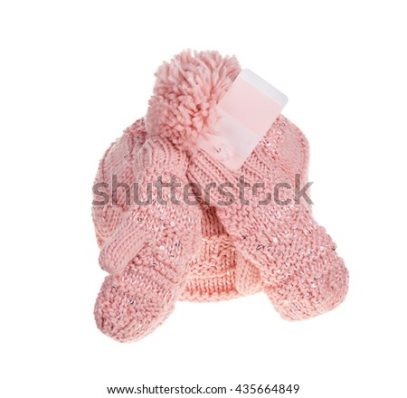 Pink knitted mittens and cap. Isolate on the white background. - stock photo