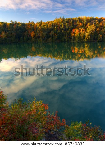 Pink lake in Gatineau Park, Quebec, Canada - stock photo