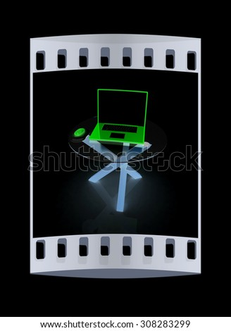 pink laptop on an exclusive table on a black background. The film strip - stock photo