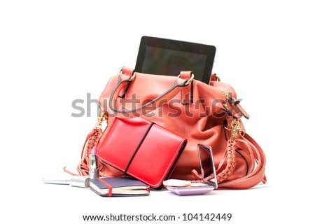 Pink Leather Ladies Handbag with Tablet PC on white background - stock photo