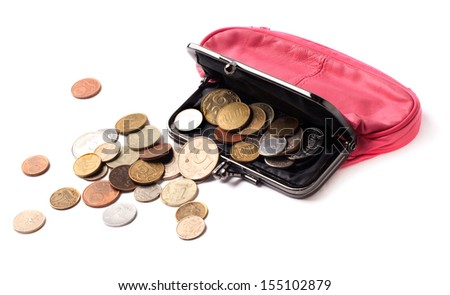 Pink leather purse and several different coins - stock photo