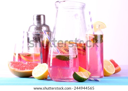 Pink lemonade in glasses and pitcher on table close-up - stock photo