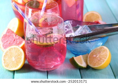 Pink lemonade in glasses on table close-up - stock photo