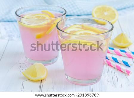 Pink lemonade with fresh lemons - stock photo