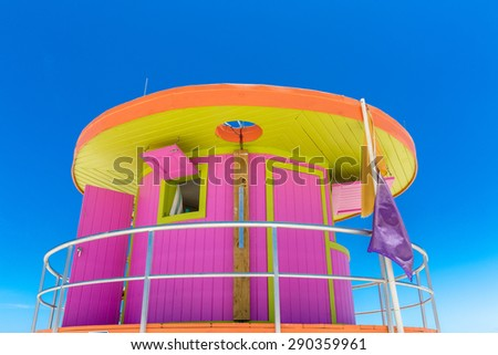 Pink lifeguard house in typical architecture during summer day in Miami Beach, Florida, USA - stock photo