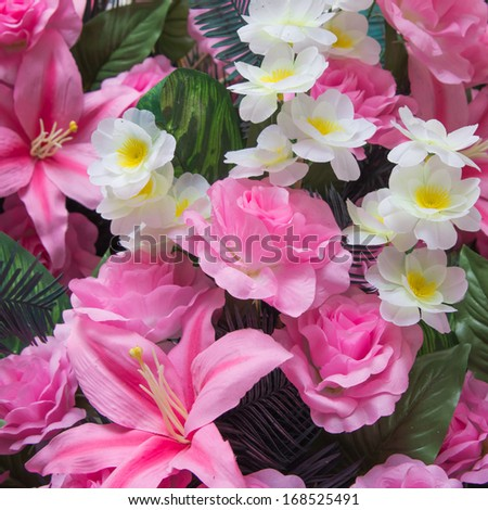 Pink lilies and pink roses. - stock photo