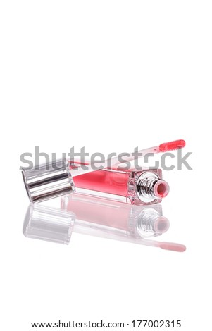 Pink lip gloss bottle on white background