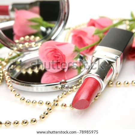 Pink lipstick and roses