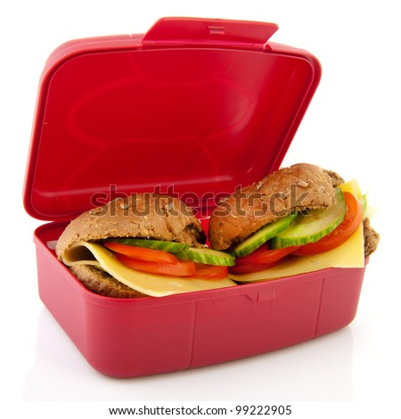 Pink lunchbox with healthy brown bread rolls cheese and vegetables - stock photo