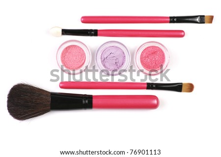 Pink make-up brushes and powder eye shadows in jars isolated on white background. - stock photo
