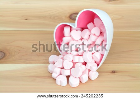 pink marshmallow in heart shape bowl  on wooden table - stock photo