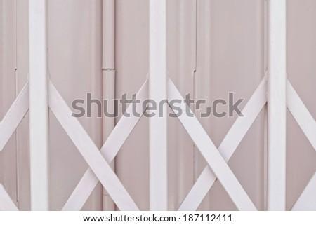 Pink metal grille sliding door - stock photo