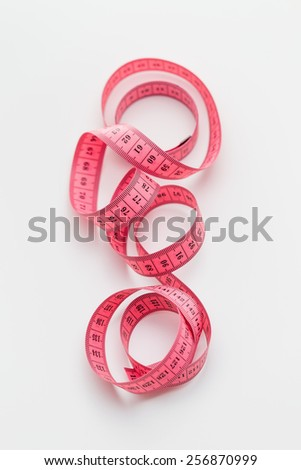 Pink metric tape measure - stock photo