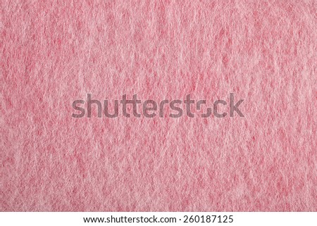 Pink nonwoven fabric texture background - stock photo