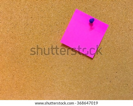 Pink note on cork board ready for your text.