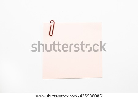 Pink note paper and dark red paper clip isolate on white background. - stock photo