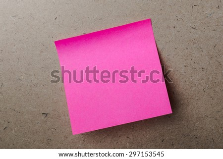Pink note paper on wood board background - stock photo
