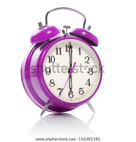 pink old style alarm clock isolated on white - stock photo