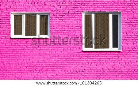 pink original wall with two windows - stock photo