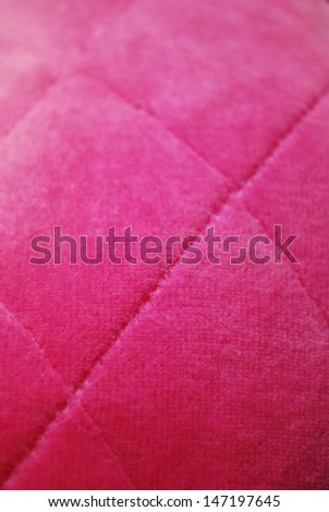 Pink padded velvet fabric texture macro background vertical - stock photo