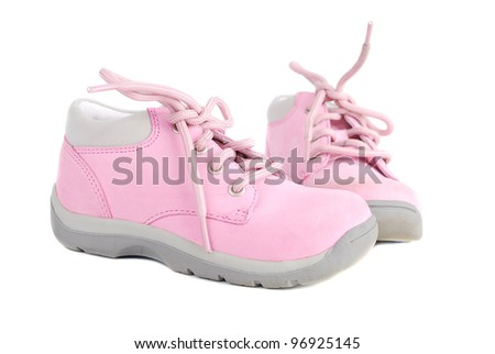 Pink pair of  baby girl little  shoes with laces isolated on the white background. - stock photo