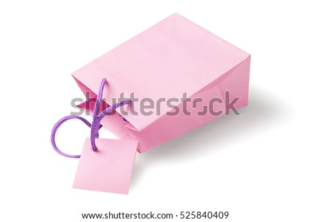 Pink Paper Bag With Tag Lying on White Background