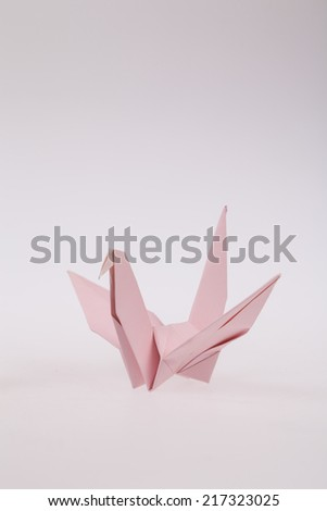Pink paper bird, origami - stock photo