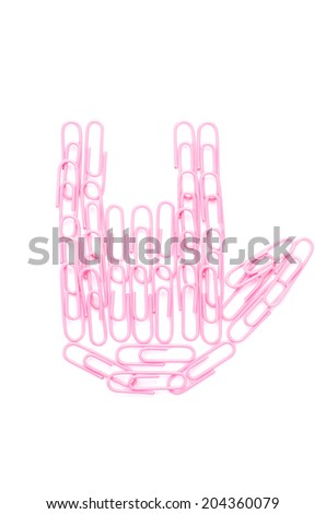 pink paper clips arranged in i love you symbol shape on isolated white background. - stock photo