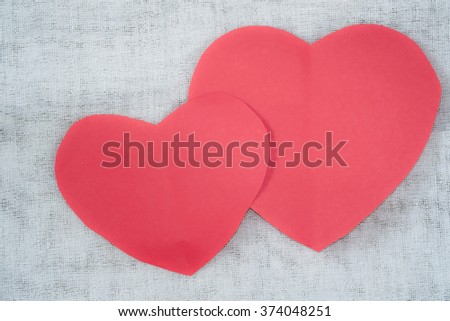 Pink paper heart on fabric background, Valentine 's Day.