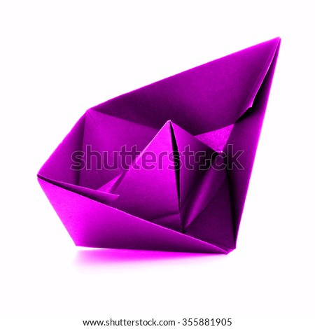 Pink paper vessel, origami sail boat, isolated on white background