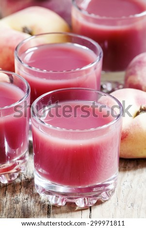Pink peach juice with pulp, selective focus