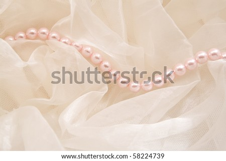 Pink pearls against a fabric
