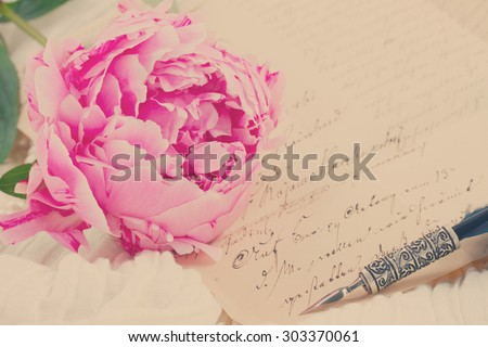 Pink peony with antique letter and feather pen, retro toned - stock photo
