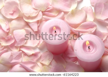 pink petals of roses and burning candles - stock photo