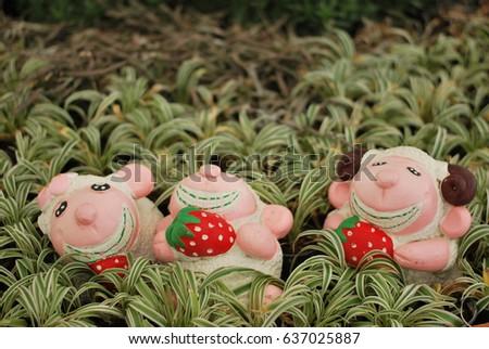 Pink Pig Statue In The Garden.
